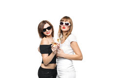 High-fashion. Glamorous stylish young women model. With red lips in a black and white bright hipster clothes and sunglasses with glasses of champagne Royalty Free Stock Photography