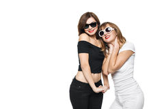 High-fashion. Glamorous stylish young women model. With red lips in a black and white bright hipster clothes and sunglasses. They laugh, rejoice, rage, indulge Stock Photo
