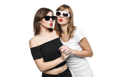 High-fashion. Glamorous stylish young women model. With red lips in a black and white bright hipster clothes and sunglasses send a kiss Royalty Free Stock Photos
