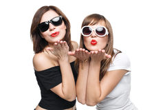 High-fashion. Glamorous stylish young women model. With red lips in a black and white bright hipster clothes and sunglasses send a kiss Stock Photography