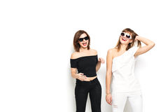 High-fashion. Glamorous stylish young women model. High-fashion. Glamorous stylish young woman model with red lips in a black and white bright hipster clothes Stock Photos
