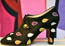 High fashion Italian shoes. Salvatore Ferragamo shoes in a shop in Florence, Italy. Italian fashion in 2011. High heeled black shoes with colorful spots Stock Images