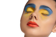 High fashion look, closeup beauty portrait,bright makeup with perfect clean skin with colorful red lips and blue yellow eyeshadows Stock Images