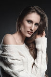 High fashion look, closeup beauty portrait of young beautiful woman. Fashion photo in white sweater Royalty Free Stock Images