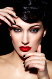 Sexy brunette with bright makeup Royalty Free Stock Photos