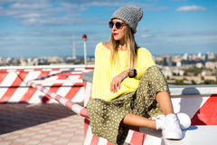 High fashion look.glamor stylish sexy beautiful young blond model girl in bright casual hipster clothes behind blue sky Stock Photos