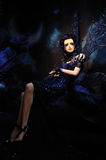 High fashion model in blue dress and fantasy s Royalty Free Stock Image