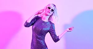 woman in Party outfit dance. Music vibrations royalty free stock photo