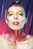 High fashion model girl portrait with colorful vivid make up. Ab. Stract colourful make-up. Glamour beauty woman portrait Royalty Free Stock Photography