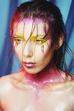 High fashion model girl portrait with colorful vivid make up. Ab Royalty Free Stock Images