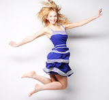 High fashion model jumps in studio Royalty Free Stock Images