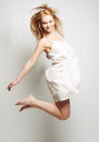 High fashion model jumps in studio Royalty Free Stock Image