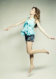 High fashion model jumps in studio Royalty Free Stock Photos