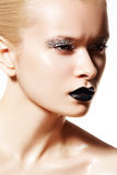 High fashion model. Silver make-up, black lips Royalty Free Stock Photography