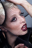 High Fashion Model Stretching Netting Over Her Face Stock Image