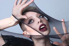 High Fashion Model Stretching Netting Over Her Face Stock Photos