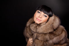 High fashion model wearing  fur vest Stock Photography