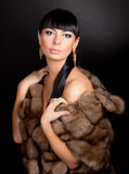 High fashion model wearing  fur vest Stock Photos