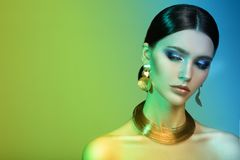 High Fashion Model Woman In Colorful Bright Lights Posing In Studio. Stock Images