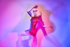 woman in Party outfit dance. Music vibrations royalty free stock photography