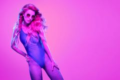 High Fashion neon light. Girl, Hairstyle royalty free stock photo