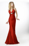 High Fashion. Shapely Blonde in Silk Evening Red Gown. Femininity. Female in Vogue  Red Gown. Femininity Stock Photos