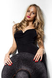 High fashion shot of blonde woman with curly hair Stock Photo