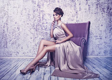 High fashion shot of young beautiful woman in gorgeous silk dres Stock Photos