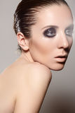 High fashion style. Model with dark gloss make-up, wet hairstyle Stock Photos
