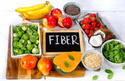 High Fiber Foods on a white wooden background. View from above royalty free stock photography