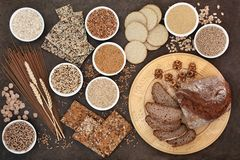High Fibre Super Food. With whole wheat pasta, whole grain walnut and rye bread, crackers, seeds, nuts, grains, oatmeal, oats, barley and bran flakes with wheat stock photography
