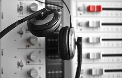 High fidelity sound guard headphones over sound mixer. High fidelity sound guard headphones over digital sound mixer  (focus on headphones Royalty Free Stock Image