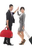 High-five. Traveling business people giving a high five and smiling at camera Royalty Free Stock Photography