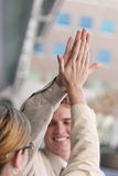 High five. Man and woman high five Royalty Free Stock Photo