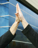 High-five. Two human hands touching palms Royalty Free Stock Photo