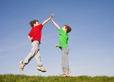 High Five. Two Boys Giving a High Five in the Sky stock image