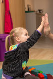 High five concept with a little girl Stock Photo