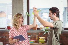 High five done by colleague in office Royalty Free Stock Photo