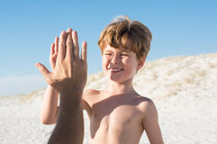 High five kid Stock Images
