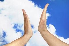 High Five Male Sky Outdoor. Male hands giving a High Five outdoor against blue sky clouds background Royalty Free Stock Image