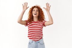 High five nice game. Attractive sociable happy european redhead curly woman raising hands up clapping friend palms. Smiling broadly laughing having fun enjoying stock images