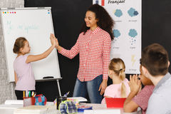 High five with teacher Stock Photo