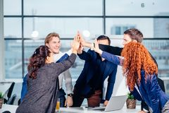 High-five. young business people giving high-five on meeting in office. High-five. cheerful young business people giving high-five on meeting in office Stock Images