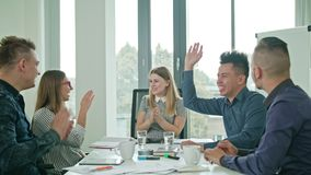 High Fives Members at a Startup in a Modern Office Stock Image