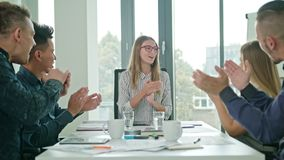 High Fives Members at a Startup in a Modern Office Stock Images