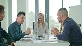 High Fives Members at a Startup in a Modern Office Royalty Free Stock Image
