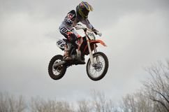 High flight of motorcycle racer on a motorcycle Royalty Free Stock Photography