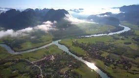High flight over landscape and sun reflection slides along river stock footage