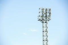 High flood light. Tall pole flood light of the football stadium on blue sky background Stock Photo