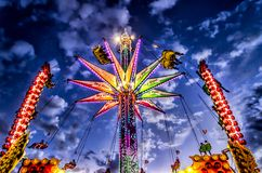 High Flying. Carnival ride and deep blue sky Stock Photo
